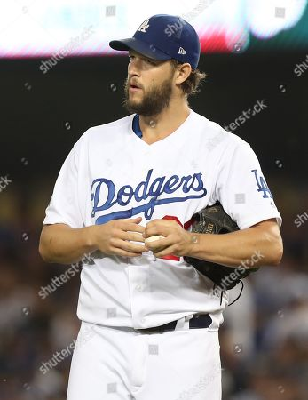 Los Angeles Dodgers starting pitcher Clayton Kershaw reacts after walking Washington Nationals Anthony Rendon in the top of the first inning of the MLB National League Division Series playoff baseball game two between the Washington Nationals and the Los Angeles Dodgers at Dodgers Stadium in Los Angeles, California, USA, 04 October 2019.