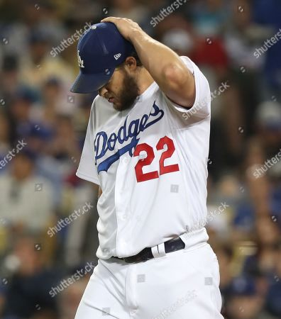 Los Angeles Dodgers starting pitcher Clayton Kershaw reacts after giving up an RBI single to Washington Nationals Howie Kendrick in the top of the first inning of the MLB National League Division Series playoff baseball game two between the Washington Nationals and the Los Angeles Dodgers at Dodgers Stadium in Los Angeles, California, USA, 04 October 2019.