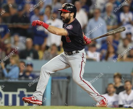 Washington Nationals right fielder Adam Eaton follows through with an RBI single off Los Angeles Dodgers starting pitcher Clayton Kershaw in the top of the second inning of the MLB National League Division Series playoff baseball game two between the Washington Nationals and the Los Angeles Dodgers at Dodgers Stadium in Los Angeles, California, USA, 04 October 2019.