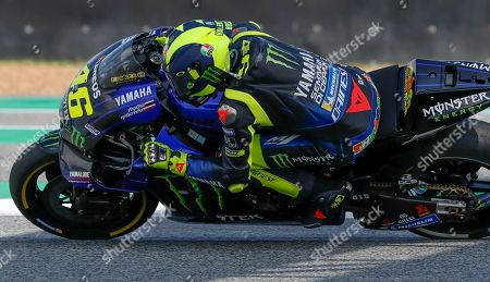Stock Photo of Italy's rider Valentino Rossi of the Movistar Energy Yamaha MotoGP Team rides during Thailand's MotoGP at the Chang International Circuit in Buriram, Thailand