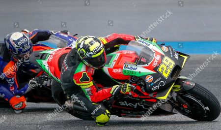 Andrea Iannone, Miguel Oliveira. Italy's Andrea Iannone of the Aprilia Racing Team Gresini, right, and Portugal's Miguel Oliveira of the Red Bull KTM Tech 3 Team ride during a free practice session ahead of qualifying Thailand's MotoGP at the Chang International Circuit in Buriram, Thailand