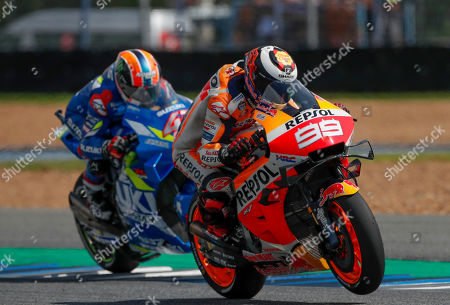 Jorge Lorenzo, Alex Rins. Spanish rider Jorge Lorenzo of the Repsol Honda Team, left and Spain's rider Alex Rins of the Suzuki Ecstar Team ride during a practice session ahead of qualifying Thailand's MotoGP at the Chang International Circuit in Buriram, Thailand