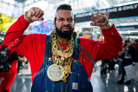 An attendee dressed as Mr. T poses during New York Comic Con at the Jacob K. Javits Convention Center, in New York