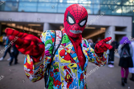 An attendee dressed as Stan Lee Spider-Man poses during New York Comic Con at the Jacob K. Javits Convention Center, in New York