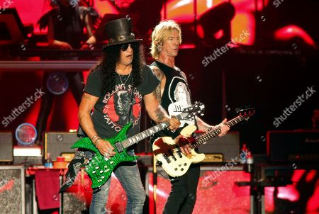 Slash, Duff McKagan. Guns N' Roses' Slash, left, and Duff McKagan perform on the first weekend of the Austin City Limits Music Festival at Zilker Park, in Austin, Texas