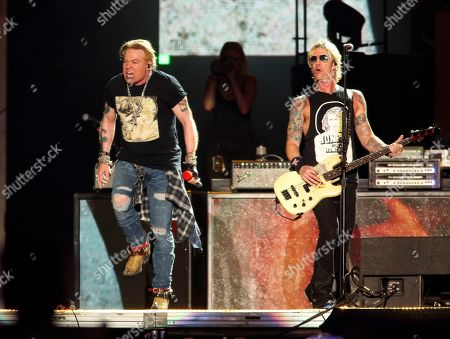 Axl Rose, Duff McKagan. Guns N' Roses' Axl Rose, left, and Duff McKagan perform on the first weekend of the Austin City Limits Music Festival at Zilker Park, in Austin, Texas
