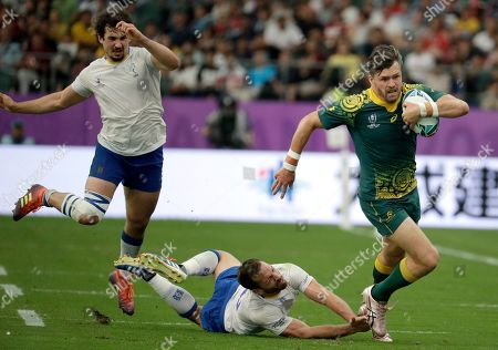 Stock Photo of Australia's Adam Ashley-Cooper makes a run during the Rugby World Cup Pool D game at Oita Stadium between Australia and Uruguay in Oita, Japan