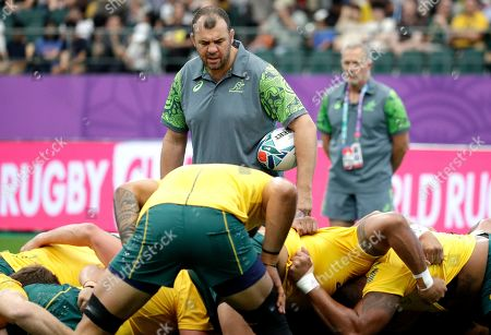 Australian coach Michael Cheika watches his team practice a scrum ahead of the Rugby World Cup Pool D game at Oita Stadium between Australia and Uruguay in Oita, Japan