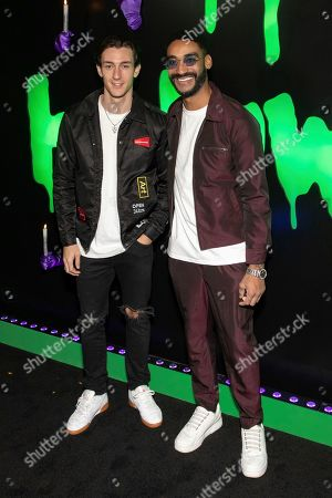 """Zeke Thomas, guest. Zeke Thomas, right, and guest attend Hulu's """"Huluween"""" television program lineup celebration during New York Comic Con at Huluween HQ, in New York"""