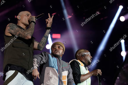 Taboo, left, apl de ap and will i am, right, of the U.S. band Black Eyed Peas perform at the Rock in Rio music festival in Rio de Janeiro, Brazil