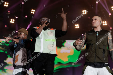 will i am, center, Taboo, right, and apl de ap of the U.S. band Black Eyed Peas perform at the Rock in Rio music festival in Rio de Janeiro, Brazil