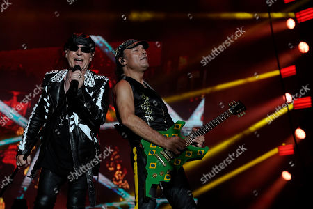 Klaus Meine, Matthias Jabs. Klaus Meine, left, and the guitarist Matthias Jabs of the band Scorpions perform at the Rock in Rio music festival in Rio de Janeiro, Brazil, early . Jabs plays the same guitar that he performed with at the first Rock in Rio festival in 1985