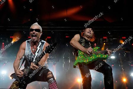 Rudolf Schenker, Matthias Jabs. Rudolf Schenker, left, and Matthias Jabs of the band Scorpions perform at the Rock in Rio music festival in Rio de Janeiro, Brazil, early