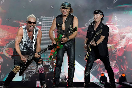 Rudolf Schenker, Matthias Jabs, Klaus Meine. Rudolf Schenker, from left, Matthias Jabs and Klaus Meine, of the band Scorpions perform at the Rock in Rio music festival in Rio de Janeiro, Brazil, early