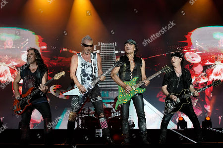 Pawe? Maciwoda, from left, Rudolf Schenker, Matthias Jabs and Klaus Meine, of the band Scorpions perform at the Rock in Rio music festival in Rio de Janeiro, Brazil, early