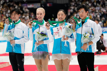 Stock Picture of Bronze medalists of team North America, pose with their medals after an awarding ceremony of Japan Open figure skating team competition at Saitama Super Arena in Saitama. Bronze medalists of team North America, from left, Vincent Zhou of the United States, Bradie Tennell of the United States, Mirai Nagasu of the United States and Nathan Chen of the United States pose with their medals after an awarding ceremony of the Japan Open figure skating team competition at the Saitama Super Arena in Saitama, Japan