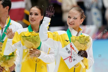 Alina Zagitova, Alexandra Trusova. Gold medalists of team Europe, from left; Alina Zagitova of Russia and Alexandra Trusova of Russia wave to spectators after an awarding ceremony at the Japan Open figure skating team competition at the Saitama Super Arena in Saitama, Japan