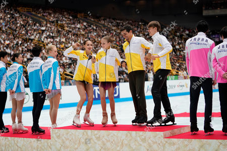 Alina Zagitova, Alexandra Trusova, Javier Fernandez, Deniss Vasiljevs. Gold medalists of team Europe, from left (in yellow), Alina Zagitova of Russia, Alexandra Trusova of Russia, Javier Fernandez of Spain, and Deniss Vasiljevs of Latvia stand on the podium during the awarding ceremony at the Japan Open figure skating team competition at Saitama Super Arena in Saitama, Japan