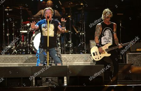 Axl Rose, Duff McKagan. Guns N' Roses' Axl Rose, left, and bassist Duff McKagan perform on the first weekend of the Austin City Limits Music Festival at Zilker Park, in Austin, Texas