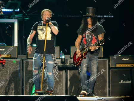 Axl Rose, Slash. Guns N' Roses' Axl Rose, left, and Slash perform on the first weekend of the Austin City Limits Music Festival at Zilker Park, in Austin, Texas