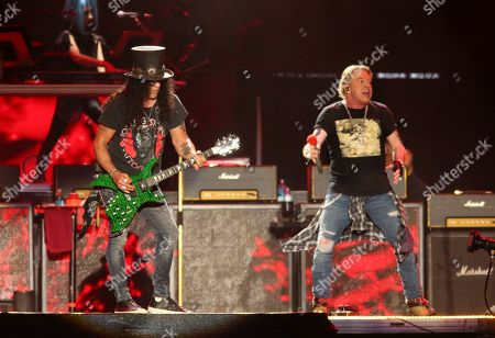 Axl Rose, Slash. Guns N' Roses' Slash, left, and Axl Rose perform on the first weekend of the Austin City Limits Music Festival at Zilker Park, in Austin, Texas
