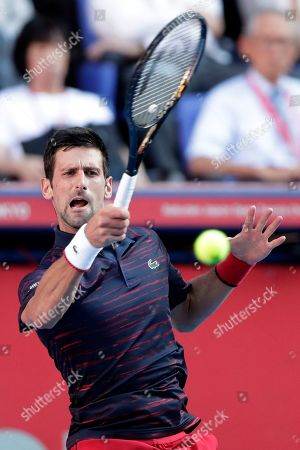 Novak Djokovic of Serbia in action against David Goffin of Belgium during the men's singles semifinal match at the Japan Open Tennis Championships in Tokyo, Japan, 05 October 2019.