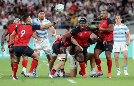 England's Maro Itoje watches as the ball goes to teammate Ben Youngs during the Rugby World Cup Pool C game at Tokyo Stadium between England and Argentina in Tokyo, Japan