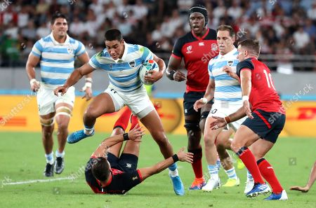 Argentina's Santiago Carreras leaps over England's Ben Youngs during the Rugby World Cup Pool C game at Tokyo Stadium between England and Argentina in Tokyo, Japan