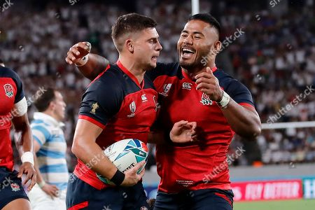 Ben Youngs, left, celebrates with Anthony Watson after scoring a try against Argentina during the Rugby World Cup Pool C game at Tokyo Stadium in Tokyo, Japan