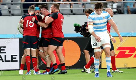 England's Jack Nowell is congratulated by teammates after scoring a try during the Rugby World Cup Pool C game at Tokyo Stadium between England and Argentina in Tokyo, Japan