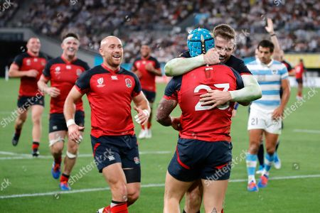 England's Jack Nowell (23) celebrates with teammates after scoring a try against Argentina during the Rugby World Cup Pool C game at Tokyo Stadium in Tokyo, Japan