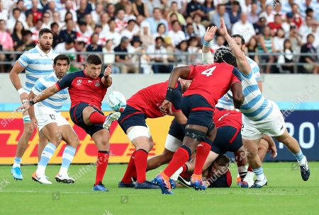 England's Ben Youngs kicks the ball during the Rugby World Cup Pool C game at Tokyo Stadium between England and Argentina in Tokyo, Japan