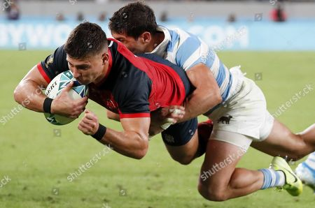 Stock Photo of Ben Youngs of England (L) scores a try past Tomas Cubelli of Argentina (R) during the Rugby World Cup match between Argentina and England at Tokyo Stadium, Tokyo, Japan, 05 October 2019.