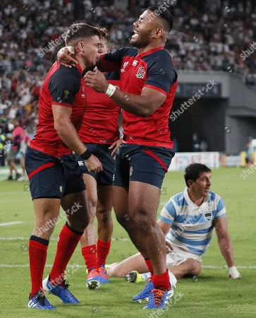 Ben Youngs of England (L) reacts after scoring a try past Tomas Cubelli of Argentina (R) during the Rugby World Cup match between Argentina and England at Tokyo Stadium, Tokyo, Japan, 05 October 2019.