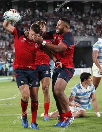 Stock Image of Ben Youngs of England (L) reacts after scoring a try past Tomas Cubelli of Argentina (R) during the Rugby World Cup match between Argentina and England at Tokyo Stadium, Tokyo, Japan, 05 October 2019.