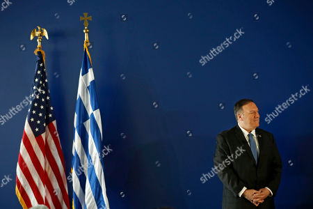 US State Secretary Mike Pompeo stands next to a Greek and a USA flag, as he waits to delvers his speech at the Stavros Niarchos Foundation Cultural Centre (SNFCC), in Athens, Greece, 05 October 2019. Pompeo is on a two-days official visit to Greece.