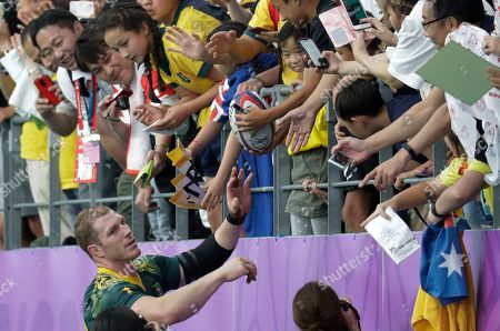 Australia's David Pocock greets the crowd following their Rugby World Cup Pool D game against Uruguay at Oita Stadium in Oita, Japan, . Australia defeated Uruguay 45-10