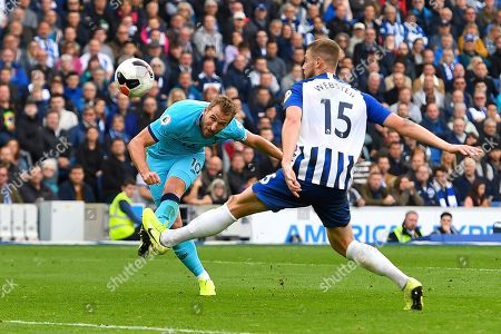Harry Kane of Tottenham Hotspur has a shot on goal under pressure from Adam Webster of Brighton and Hove Albion during Brighton & Hove Albion vs Tottenham Hotspur, Premier League Football at the American Express Community Stadium on 5th October 2019