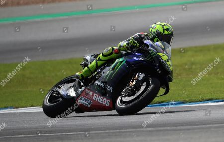 Italy's rider Valentino Rossi of the Movistar Energy Yamaha MotoGP Team enters a turn during the qualifying Thailand's MotoGP at the Chang International Circuit in Buriram, Thailand