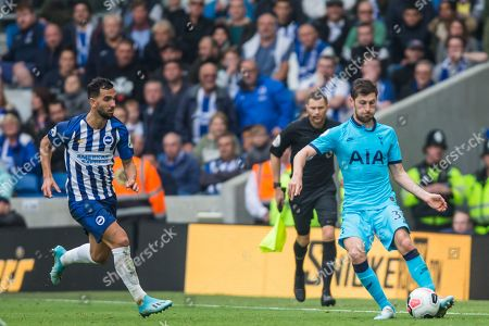 Martin Montoya (Brighton) & Ben Davies (Tottenham) with the ball during the Premier League match between Brighton and Hove Albion and Tottenham Hotspur at the American Express Community Stadium, Brighton and Hove