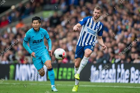 Heung-Min Son (Tottenham) coming up on the inside of Adam Webster (Brighton) who has control of the ball during the Premier League match between Brighton and Hove Albion and Tottenham Hotspur at the American Express Community Stadium, Brighton and Hove