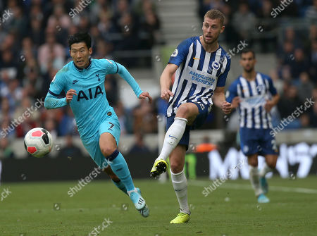 Brighton's Adam Webster vies for the ball against  Tottenham's Son Heung-Min (L) during an English Premier League soccer match between Brighton & Hove Albion and Tottenham Hotspur at the Amex Stadium in Brighton, Britain 5 October 2019.