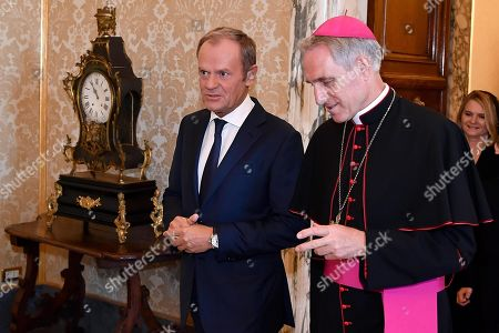 European Council President Donald Tusk (L), accompanied by Archbishop Georg Gaenswein (R), Prefect of the Papal Household, arrives for a meeting with Pope Francis at the Vatican, 05 October 2019.