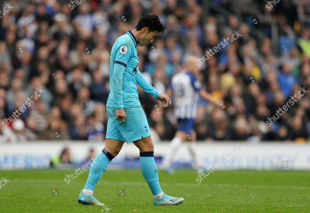 Tottenham's Son Heung-min is dejected after missing an opportunity to score during the English Premier League soccer match between Brighton and Hove Albion and Tottenham Hotspur at Falmer stadium in Brighton, England