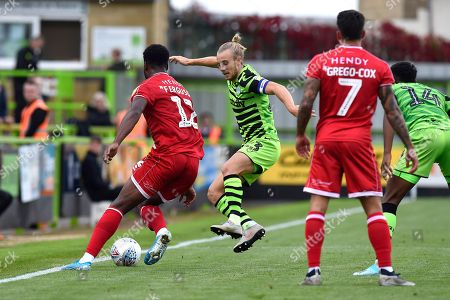 Joseph Mills (23) of Forest Green Rovers challenges Nathan Ferguson (12) of Crawley Town during the EFL Sky Bet League 2 match between Forest Green Rovers and Crawley Town at the New Lawn, Forest Green