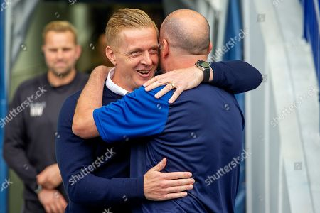 Sheffield Wednesday Manager Garry Monk greets Wigan Athletic Manager Paul Cook as he enters onto the pitch during the EFL Sky Bet Championship match between Sheffield Wednesday and Wigan Athletic at Hillsborough, Sheffield