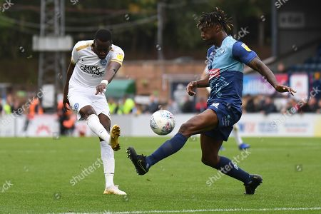 Peterborough United forward Mohamed Eisa (7) takes a shot at goal  under pressure from Wycombe Wanderers defender Anthony Stewart (5) during the EFL Sky Bet League 1 match between Wycombe Wanderers and Peterborough United at Adams Park, High Wycombe