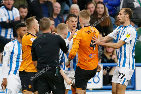 Stock Image of Referee David Webb sorts out an altercation during the EFL Sky Bet Championship match between Huddersfield Town and Hull City at the John Smiths Stadium, Huddersfield
