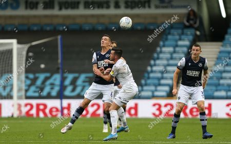Kalvin Phillips of Leeds United and Shaun Williams of Millwall challenge for the ball