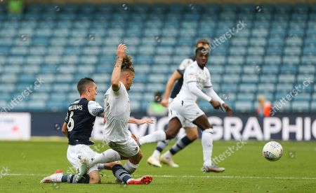 Kalvin Phillips of Leeds United and Shaun Williams of Millwall go in for a tackle